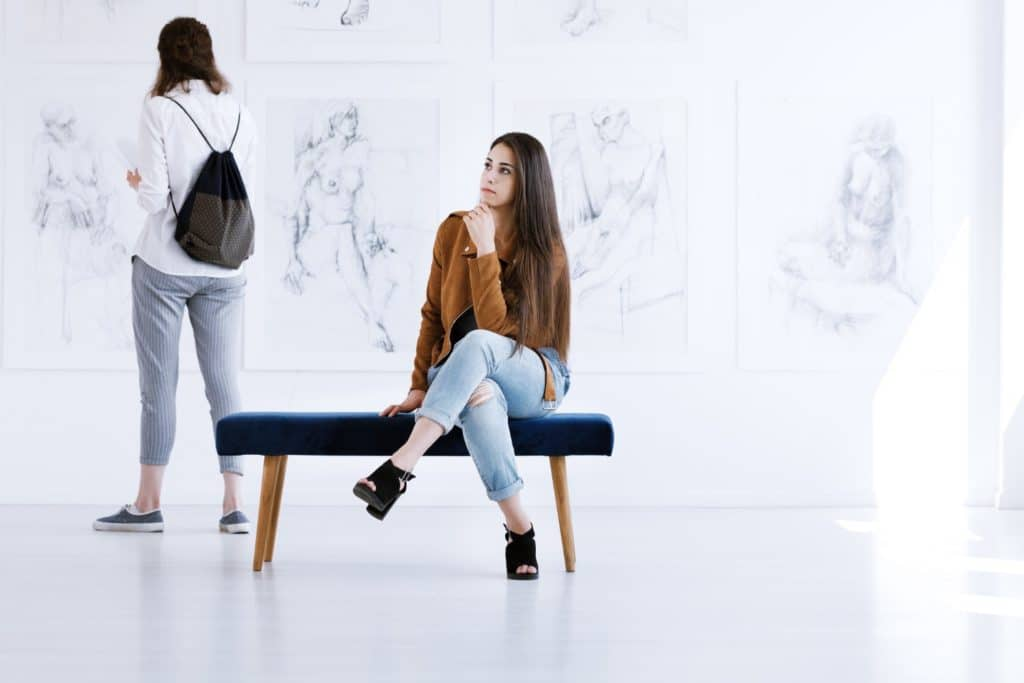 Woman contemplating female paintings at Wadsworth Museum