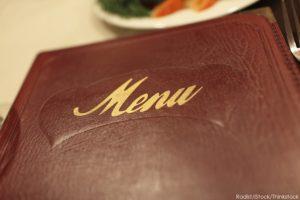 Looking at the menu during Mystic Restaurant Week