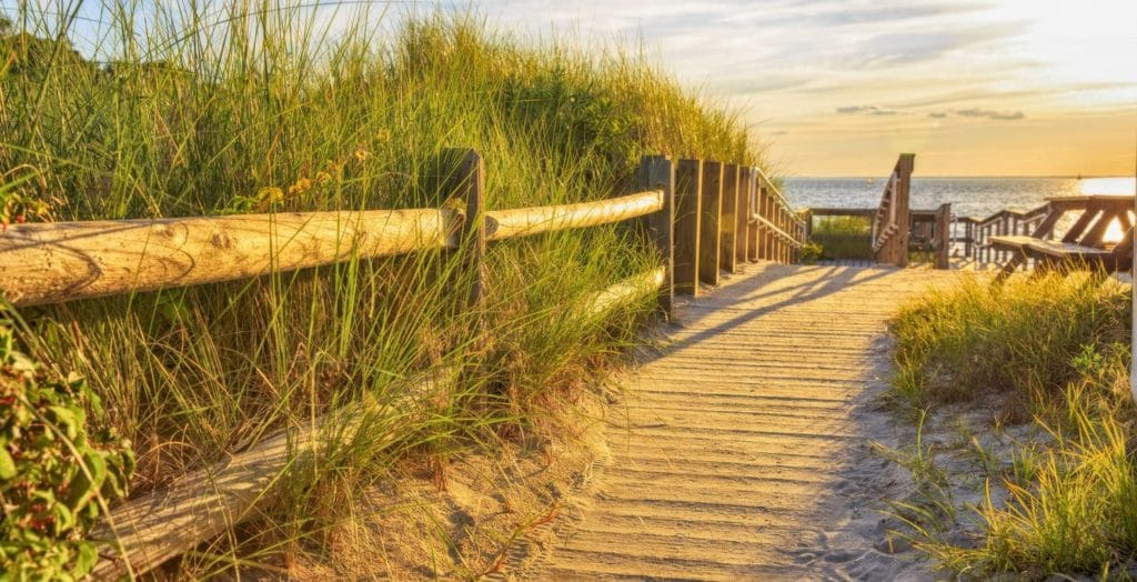 Ramp and wooden path to the sandy beach at sunset, beaches near Mystic, CT